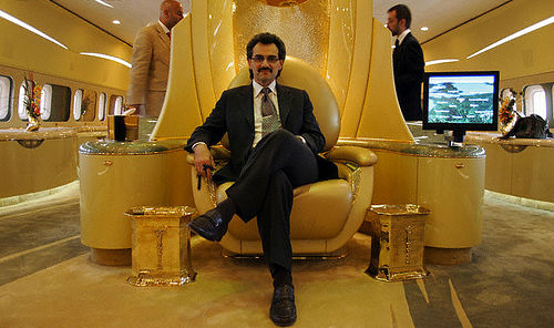 Prince Alwaleen sitting on his throne inside his private (Boeing 747) jet